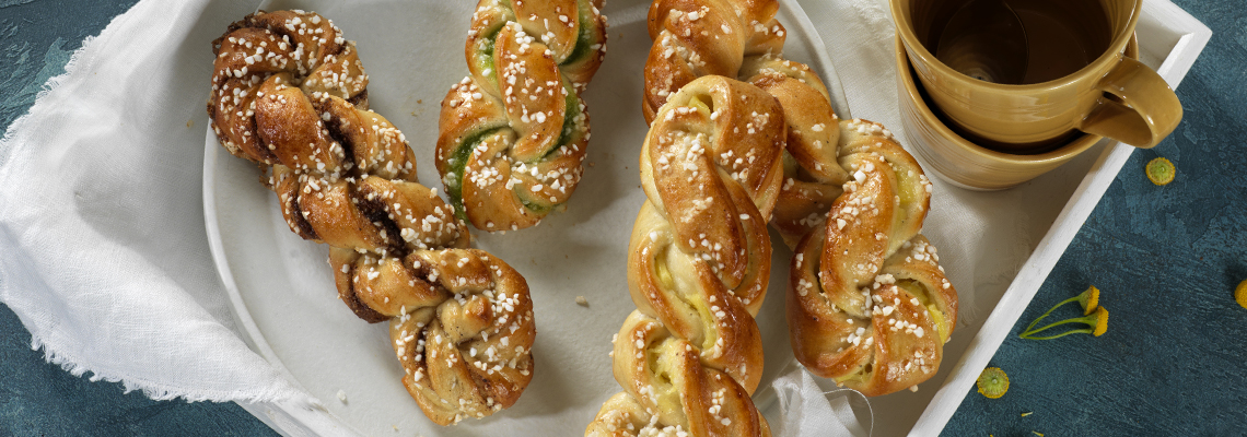 Hvetebakst av bake-off. Hvetefletter i smakene pistasj, vanilje og kanel.